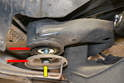 Track Control Arm- With the rear sub-frame bolt still safely secured loosen the front bolt (yellow arrow).