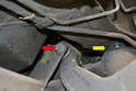 Track Control Arm- After the sub-frame has been lowered (yellow arrow) it is much easier to get access to the 18mm nut and bolt (red arrow).