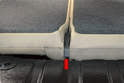 Rear Seat Backs: With the seats folded forward, move the carpet in the trunk and remove the trim piece between the seats (red arrow); it just pulls straight up.