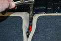 Rear Seat Backs: Use a T30 Torx and remove the single screw on the bracket between the seats (red arrow).