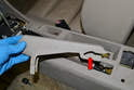Slide the brake handle trim piece forward and off the mechanism.