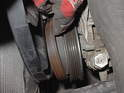 Here the serpentine belt has been removed from the power steering pulley.
