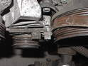 The right hand bolt for the air conditioning belt's idler pulley is preventing the removal of the serpentine belt.