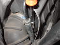 Wedge a screwdriver between the hose and the airbox in order to break its hose's seal and release it from the airbox.