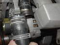 This is the upper radiator hose, where it meets the coolant pipe that runs along the top of the intake manifold.