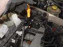 Remove the oil dipstick, which is situated between the second and third intake runners.