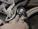 Use a 7mm Allen wrench to remove both upper and lower caliper bolts.