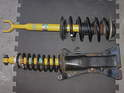 The Bilstein-equipped, assembled strut assembly for the front suspension is at top; the rear strut assembly is below.