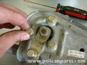 Secure the new motor to the linkage assembly with the same 10 mm bolts, tightened to 71 in-lbs.
