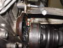 Use an 8mm Allen-head wrench or socket to remove the three axle heat shield bolts.