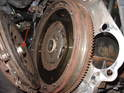 As you remove the pressure plate, put your finger into the central hole to secure the clutch disc as you lean the whole clutch apparatus away from the flywheel.