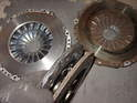 Another comparison shot of new (left) and old pressure plates and clutch discs.