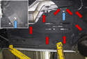 With your vehicle raised and supported safely, look under the vehicle in the area of the driver floor.