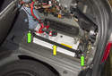 Replacing battery: Using a 13mm socket, remove the two battery hold down fasteners (green arrows).