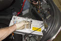 Replacing battery: Lift the battery up and remove it from the trunk.