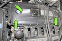 Late 6-cylinder with plastic valve cover: Remove the three 5mm Allen engine cover fasteners (green arrows).