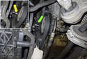 Using a ratchet with a long handle and an 8mmm Allen bit (yellow arrow), rotate the drive belt tensioner clockwise to release the tension and slide the belt off the pulleys (green arrow).