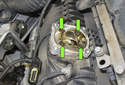 To replace the Valvetronic motor pedestal seal, remove the four T25 Torx fasteners (green arrows).