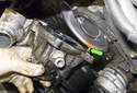 Tilt the top of the coolant pump away from the engine as you lift.