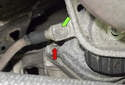 Next, you have to remove the E10 engine mount bolts (red arrow).