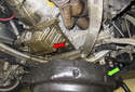Place the container (green arrow, with a volume of 8 quarts of engine oil) under the engine oil pan.