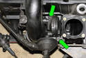 M54 6-cylinder engine: Remove crankcase breather valve fasteners (green arrows) then remove crankcase breather valve from engine.