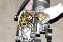 M54 6-cylinder engine: Pull the oil filter housing away from the engine and remove it.