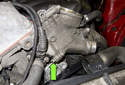 NG6 6-cylinder engines: Remove the E10 oil filter housing fastener (green arrow).