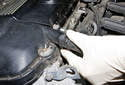 M54 Engine Intake VANOS Solenoid: Working at the left front corner of the cylinder head cover, disconnect the crankcase vent hose by squeezing the release tabs and pulling them away from the valve cover.