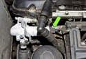 M54 Engine Intake VANOS Solenoid: Disconnect the VANOS solenoid electrical connector (green arrow).