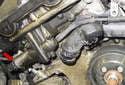 M54 Engine Exhaust VANOS Solenoid: Disconnect the VANOS solenoid electrical connector (red arrow).