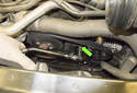 Working next to the alternator, locate the drive belt tensioner (green arrow).