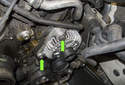 Next, remove the two 16mm alternator fasteners (green arrows).