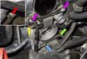 Follow the engine oil dipstick tube down toward the engine mount.
