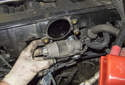 Then pull the idle valve out of the intake manifold and remove it.