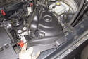 Remove strut tower plastic cover from the vehicle.