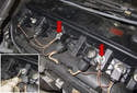 Working at the center of the valve cover, remove the 8mm and ground strap buts (red arrows) from valve cover fastener.