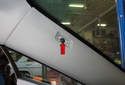 A-pillar trim: Next, remove the T20 Torx fastener from the A-pillar trim panel (red arrow).