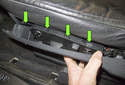 B-pillar trim: This photo shows the clips you have to detach to remove the trim piece (green arrows).
