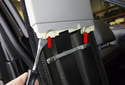B-pillar trim: Using a trim panel tool, detach the upper B-pillar trim panel clips (red arrow).