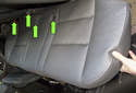 Rear Seat: Then lift the seat cushion up and out of the vehicle while feeding the seat belt buckles out of the holes (green arrows).