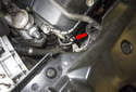 Testing with sensor installed: The exhaust camshaft sensor is located at the right front of the cylinder head (red arrow).