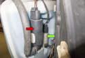 The headlight washer pump (red arrow) is the outer pump and the windshield washer pump is mounted inward (green arrow).