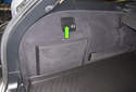 Fender taillight: Working in the trunk, open the carpeted door to access the taillight bulb socket.