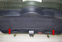Tailgate taillight: To access the tailgate lights, rotate the locks (red arrows) 45° counterclockwise.
