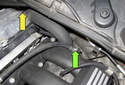 Working at the rear of the intake manifold, remove the fuel line T25 Torx mounting fastener (green arrow).