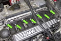 Remove the seven 11mm intake manifold nuts (green arrows).