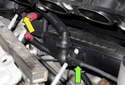 Slide the intake manifold away from the cylinder head to access the hoses and electrical connectors.