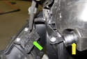 Next, reach behind the crankcase breather valve (yellow arrow) and disconnect the crankcase breather valve heater element electrical connectors (green arrow).