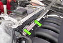 Normally aspirated engine: Then release the fuel injector harness strip from the fuel injectors.